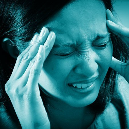 woman with extreme headache