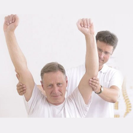Therapist assessment of shoulders of a man